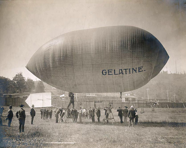 A blimp with the word 'Gelatine' on its surface, Angelus Studio photographs, 1880s-1940s