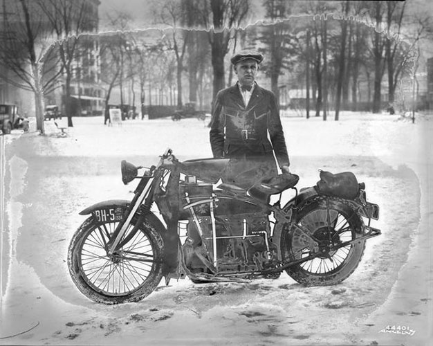 Man with Motorcycle in the Snow, Angelus Studio photographs, 1880s-1940s