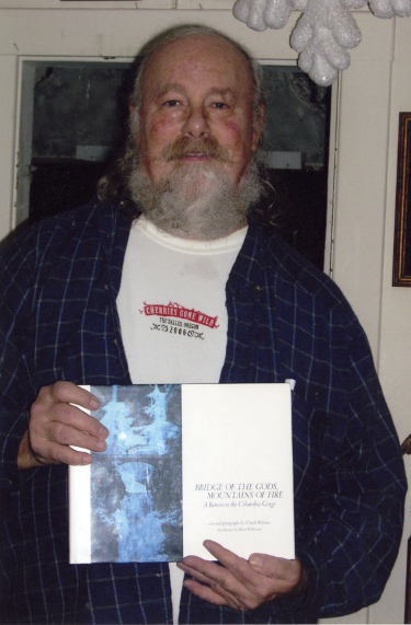 Portrait of Chuck Williams holding his book Bridge of the Gods, Mountains of Fire: A Return to the Columbia Gorge, Chuck Williams Photographs