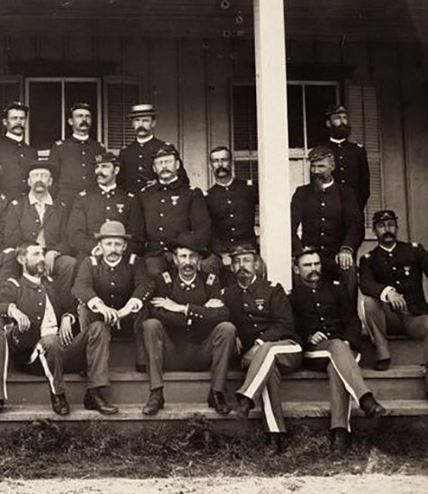 Cavalry officers seated on steps of a building at Fort Lewis, Colorado. Frazier Boutelle at right., Frazier A. Boutelle photographs, c. 1865-1924