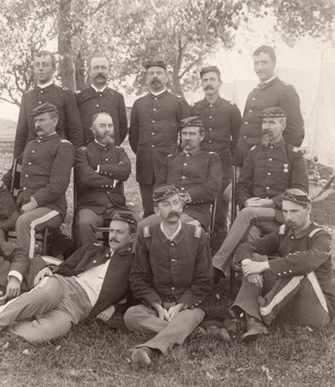 Cavalry officer group posed in woods. Frazier Boutelle at right, seated, with one medal and two bars on shoulder patch., Frazier A. Boutelle photographs, c. 1865-1924
