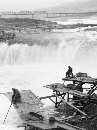 Men fishing at Celilo Falls on the Columbia River, Gerald W. Williams Collection