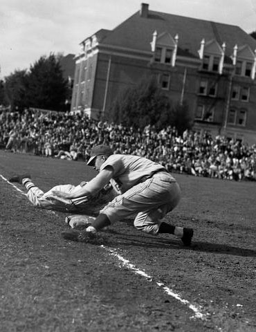 A close play at first base, 1948, Oregon State University Athletics
