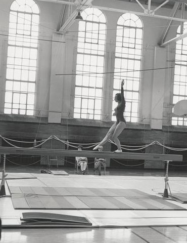 An OSU gymnast performs in the Womens Building, 1969, Oregon State University Athletics