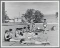 Students sunbathing on the roof of Snell Hall