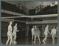 Women playing volleyball in the Women's Building, 1938