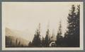 Car camping in the mountains with peak in background (possibly Mt. Hood), circa 1910