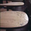 Carvings on a classroom desk