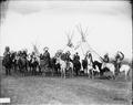 Indians on horses in front of tepees