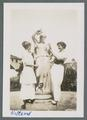 "Two women with ""Lady of the Fountain"" statue, circa 1914"