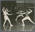 Women fencing in gym class, 1938