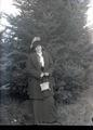 Woman standing in front of a fir tree