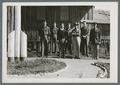 Civilian Conservation Corps men standing outside headquarters