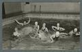 Women swimming in pool, probably playing water polo, 1938