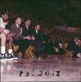 Coach Paul Valenti with his staff on the OSU basketball bench