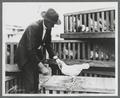 Frank Knowlton of the Poultry Department, with White Leghorn Hen, 1921