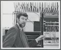 Fred Tonge posing with the PDP-11 computer.