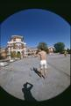 Fisheye view of a frisbee toss near Weatherford Hall