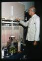 Horticulturist Dr. Elmer O. Hansen testing atmospheric conditions in pear storage, 1963
