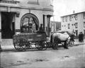 Farm wagon in front of Benton County National Bank