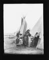 Woman with children at entrance to tipi