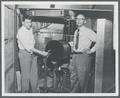 David Nicodemus and Richard Dempster, faculty members in the Physics Department, posing with the OSC cyclotron
