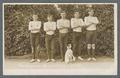 The 1911 Freshmen wrestling team posing with Arbuthnot's dog