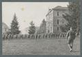 Cadets walking line abreast on lower campus, circa 1920