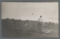 Airborne football during game, circa 1910