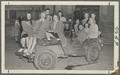 Delta Zeta sorority sisters posing in an Army Jeep after finishing second in a war bond contest