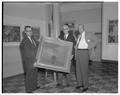 Gordon Gilkey, August Strand and an unidentified individual posing with a painting.