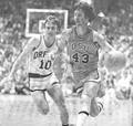 Guard Brian Hilliard drives past U of O's Mike Drummond