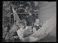 H. T. Bohlman and W. L. Finley reading on the porch