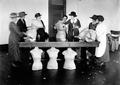 Community leaders in Clatsop County work with dress forms, 1923