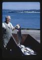 Max Kingery and salmon at Marine Science Center, circa 1965