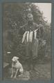 Arbuthnot and his dog with the day's catch of fish, circa 1910