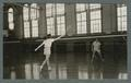 Badminton in the Women's Building, played by two women, 1940