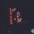 Sign for the Toa Yuen restaurant illuminated at night