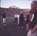 Head coach Tommy Prothro with his players and assistants on the OSU sideline, 1965 Rose Bowl football game