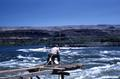Man fishing on platform above Celilo Falls on the Columbia River