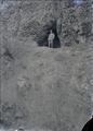 Benjamin A. Gifford standing at entrance to cave