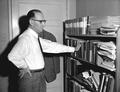 Bernard Malamud at a bookshelf