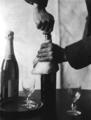 Hands of John Jacob Niles, opening bottle of wine
