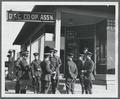 Military officers standing outside of the OAC Co-Op on 15th Street (site of the present day Kerr Administration Building)