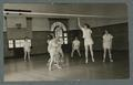 Women playing volleyball during gym class in Women's Building, 1940