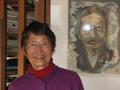 Yoko McClain with portrait of her grandfather, Natsume Soseki