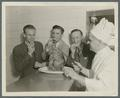 Don Findlay, Bob Fischer, and Coach Grant Swan posing with a chef, circa 1945
