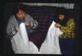 Master Artist Khen Chiem Saepharn working with Apprentice Meuy Fow Saephan on Mien embroidery (TAAP 1992-93)