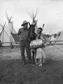 Young Native American woman with cowboy and horse