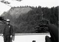 Ranger (John Currie) standing on dock at Visitor center look north at Cape Perpetua